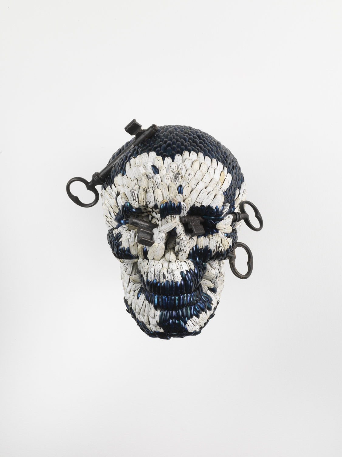 Jan Fabre, Skull with the Keys of Hell, 2013, Mixture of jewel beetle wing-cases, polymers, iron, 23 x 21 x 20cm